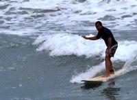 Tony Cortes surfing